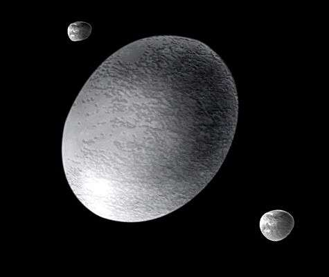 Représentation d'artiste de Haumea et ses satellites Hi'iaka et Namaka. Crédit : A. Feild (Space Telescope Science Institute)