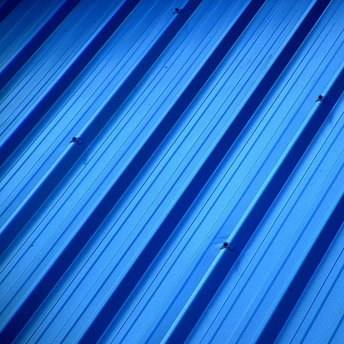 L'ordre de pose est un élément essentiel de la toiture en bardage. © OliBac, Flicr, CC BY 2.0