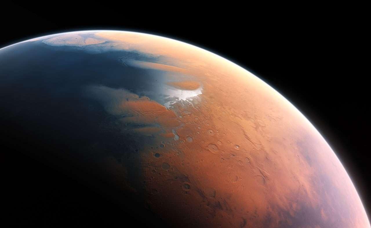 Cette illustration suggère l'environnement humide de Mars voici 4 milliards d'années. La toute jeune planète devait renfermer suffisamment d'eau liquide pour que l'intégralité de sa surface en soit couverte, sur une hauteur d'environ 140 m. Il semble plus probable toutefois que l'eau liquide se soit constituée en un océan occupant près de la moitié de l'hémisphère nord de la planète. En certaines régions, la profondeur de cet océan pouvait dépasser 1,6 km. © Eso, M. Kornmesser