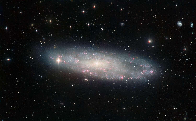 NGC 247, la galaxie du Sculpteur imagée par le télescope de 2,2 mètres du Chili. © ESO