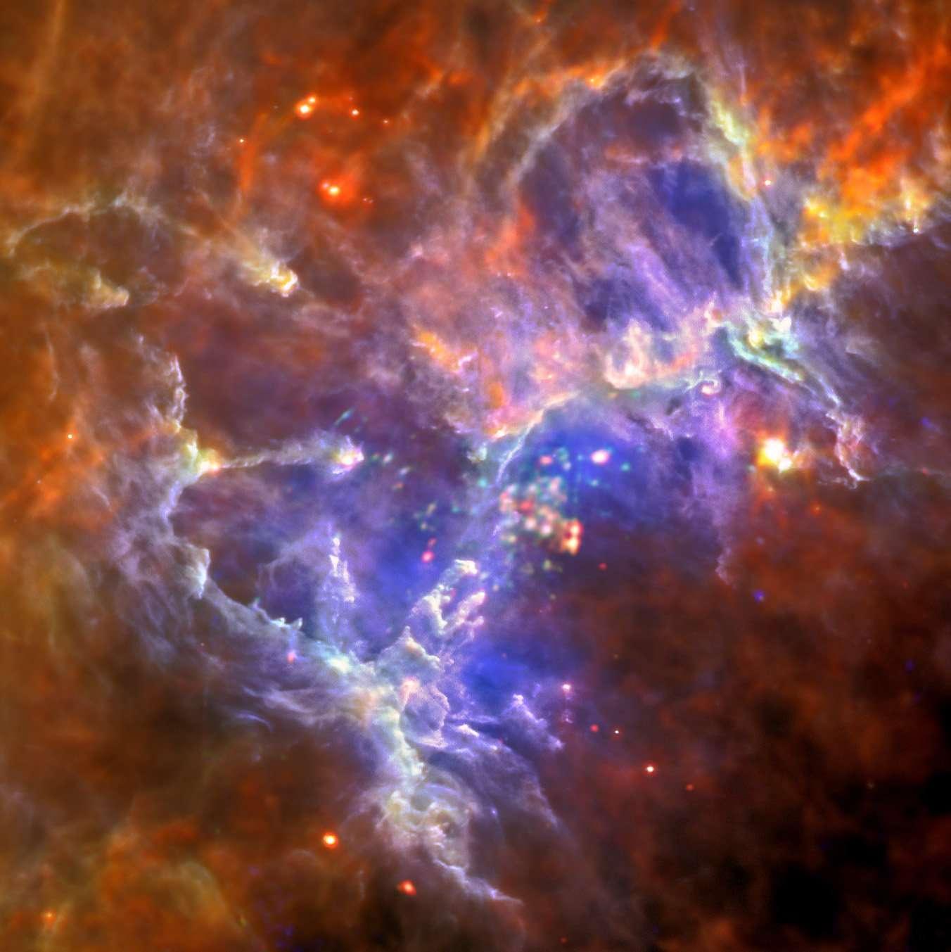 Nouvelle vision des Piliers de la Création grâce aux télescopes spatiaux Herschel et XMM-Newton. © infrarouge lointain : Esa/Herschel/Pacs/Spire/Hill, Motte, Hobys Key Programme Consortium; rayons X : Esa/XMM-Newton/Epic/XMM-Newton-Soc/Boulanger