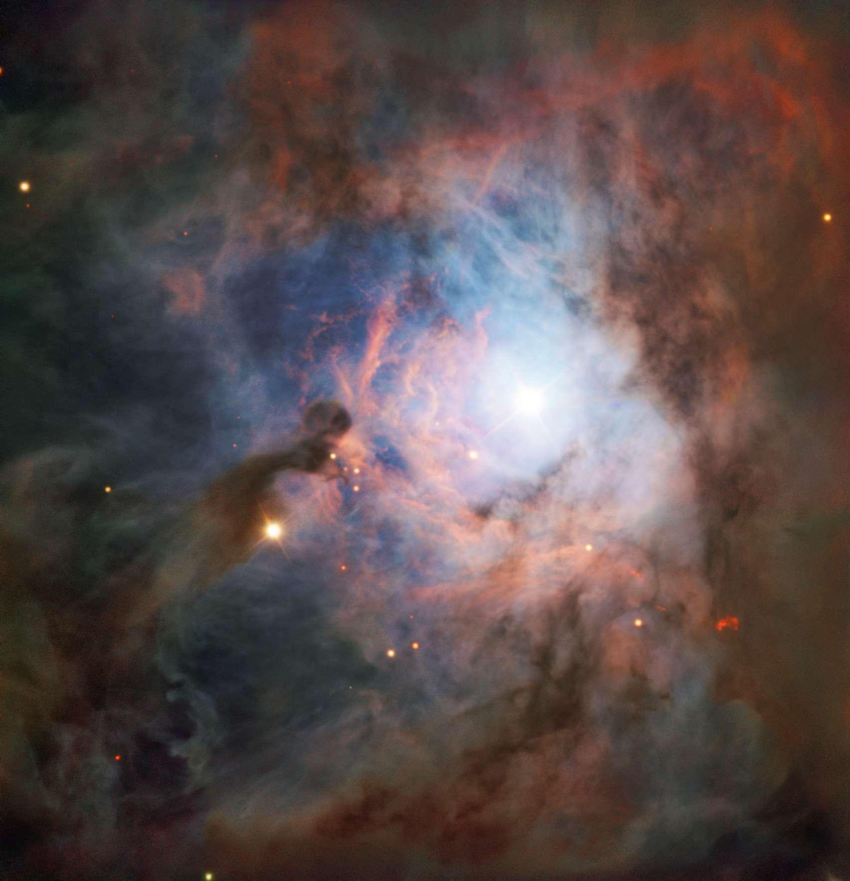 La toile de gaz et de poussière de NGC 2023 luit de la lumière de la jeune étoile HD 37903. © ESO