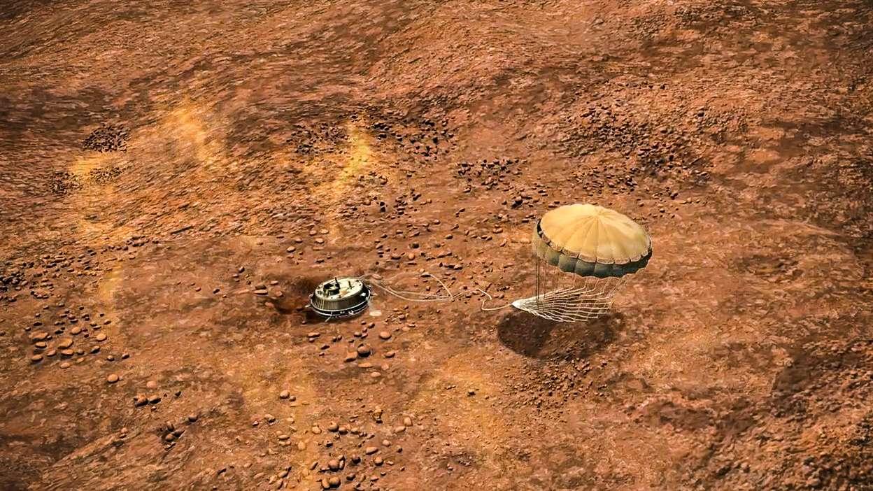 Une vue d'artiste du module Huygens sur Titan. Le parachute du module européen est en train de se coucher sur le sol. © Esa, C. Carreau