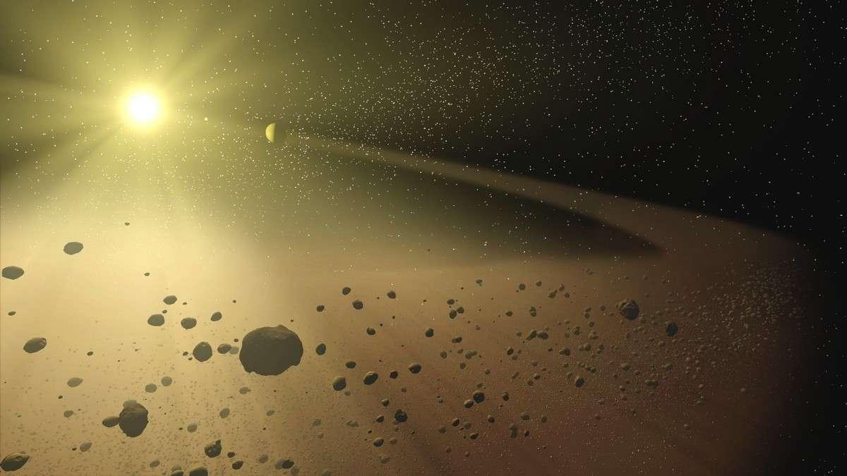 24 Thémis, un des membres de la ceinture d'astéroïdes (représentée ici par un artiste), vient sans doute d'apporter une preuve éclatante de l'origine extraterrestre de l'eau. Crédit Nasa