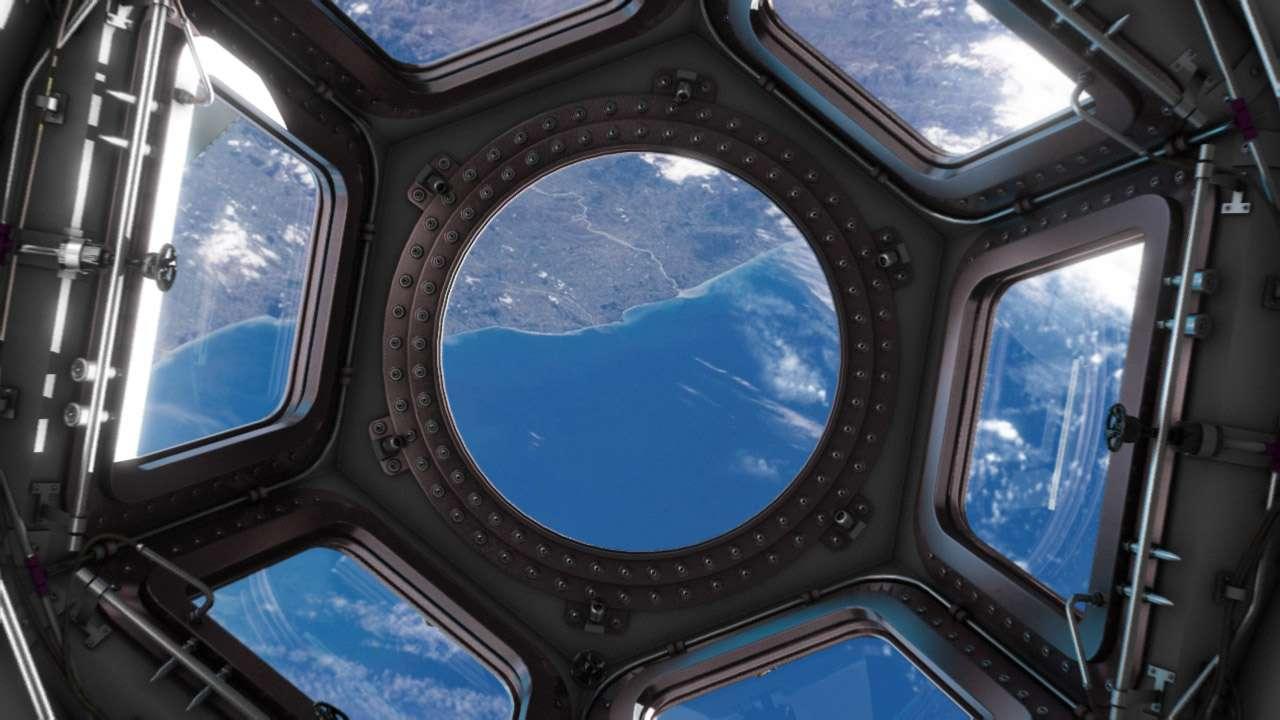 Une image de synthèse de la Coupole (Coupola) et la vue qu'elle donnera aux astronautes lorsqu'elle sera en place sur l'ISS. © Thales Alenia Space