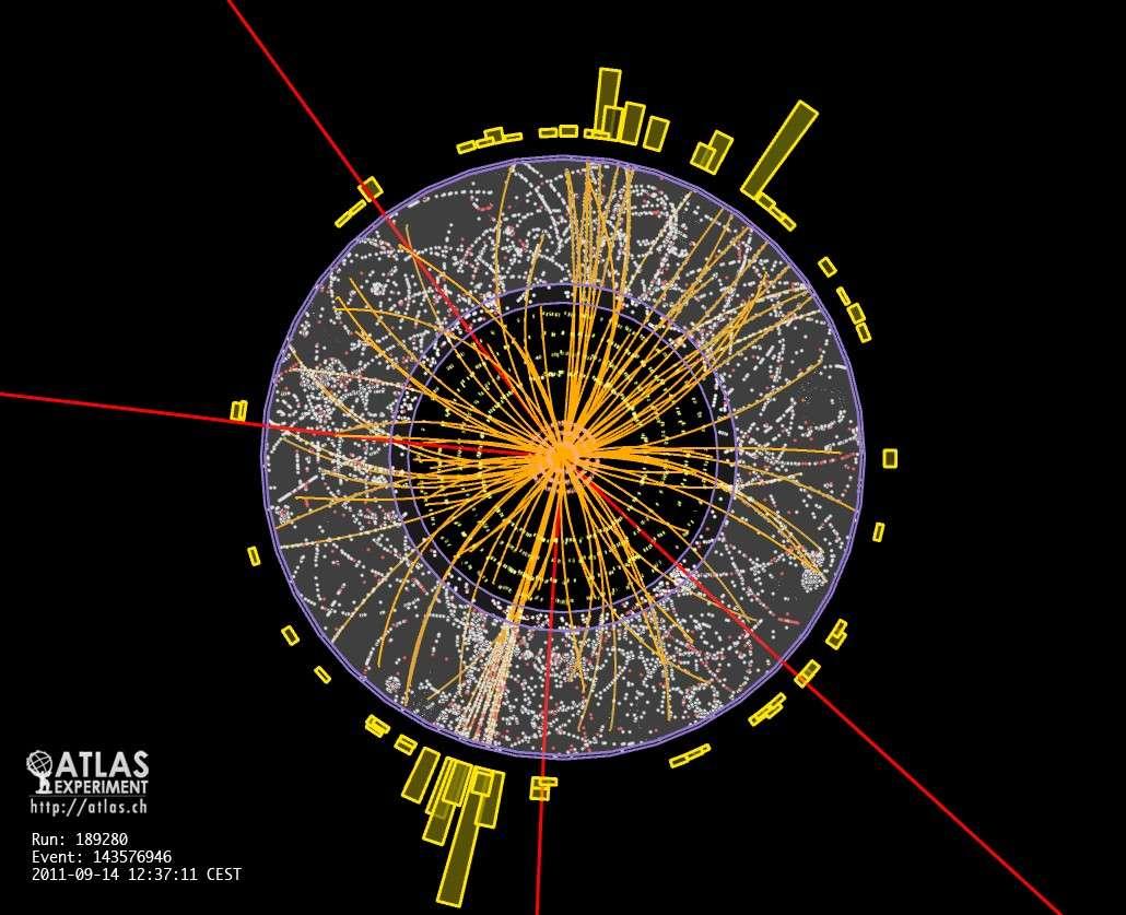 Quatre muons bien particuliers ont laissé des traces représentées en rouge dans le détecteur Atlas en 2011. Ces muons pourraient être le produit de la désintégration d'un boson de Higgs. © Cern