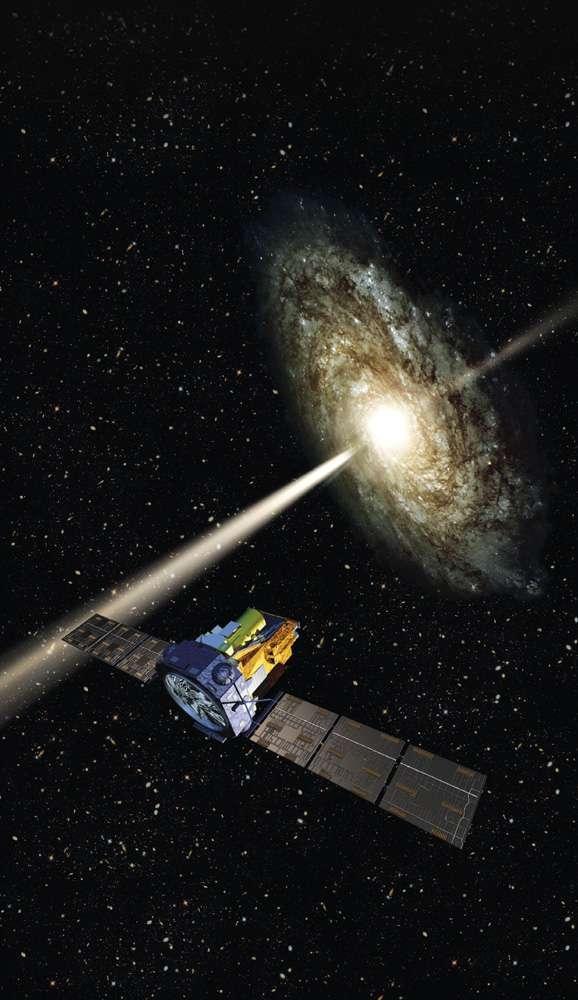 Une vue d'artiste du satellite Integral observant un noyau actif de galaxie et ses jets de matière. Crédit : Esa