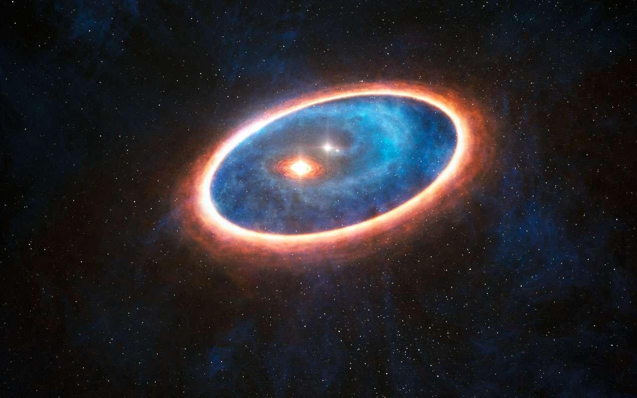 Cette vue d'artiste montre le gaz et la poussière qui entourent le système d'étoiles doubles GG Tauri-A. Des chercheurs ont détecté, au moyen d'Alma, la présence de gaz dans la région séparant les deux disques de ce système binaire. Cette structure est susceptible de favoriser la formation de planètes au sein de l'environnement gravitationnellement perturbé du système binaire. © Eso, L. Calçada