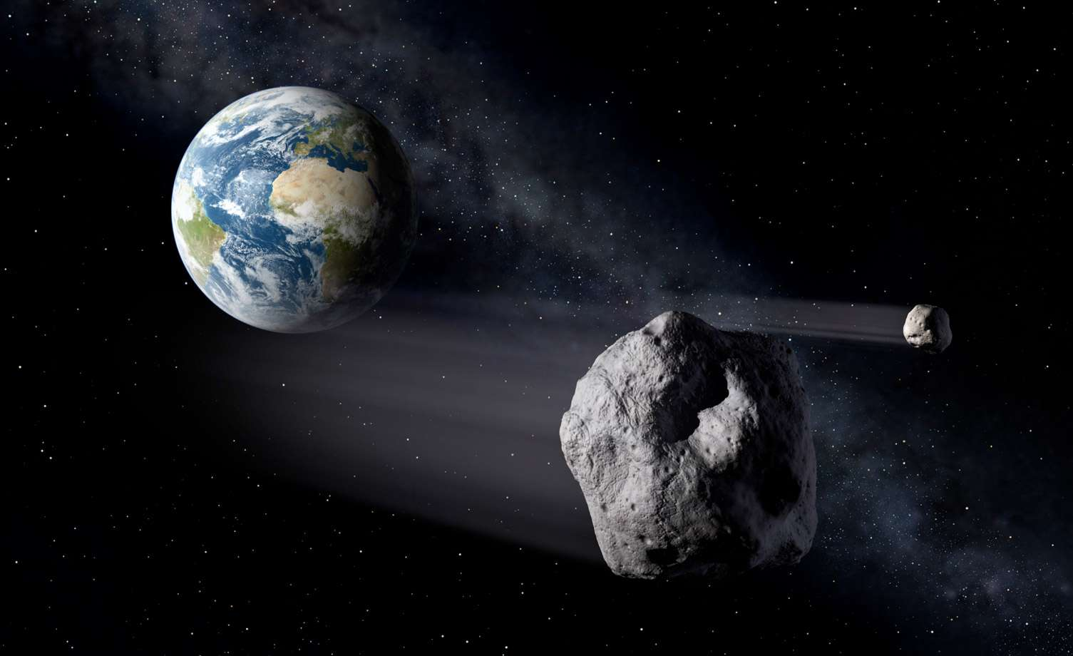Cette vue d'artiste montre des astéroïdes aux environs de la Terre. Les experts de l'Esa souhaitent coordonner leurs efforts en matière de détection et éventuellement de déviation de ces objets dangereux. © P. Carril, Esa