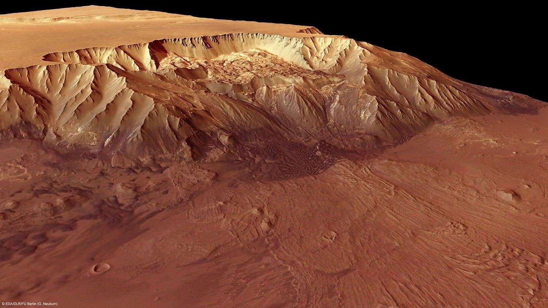 À 9 km sous le niveau moyen de la surface de Mars, Melas Chasma est sans doute le canyon le plus profond de la planète. C'est aussi un des sites d'atterrissage envisagés pour une mission humaine car il présente plusieurs intérêts. © Esa/DLR/FU Berlin/G. Neukum