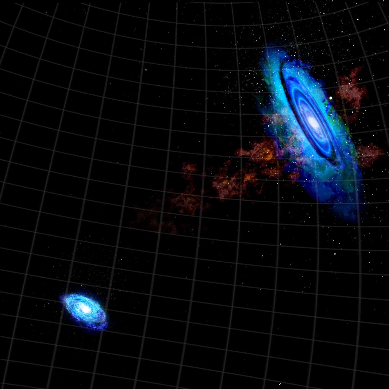 Cette image révèle l'écharpe d'hydrogène gazeux décelée entre les galaxies d'Andromède et du Triangle, preuve d'une rencontre très ancienne. © Bill Saxton/NRAO/AUI/NSF