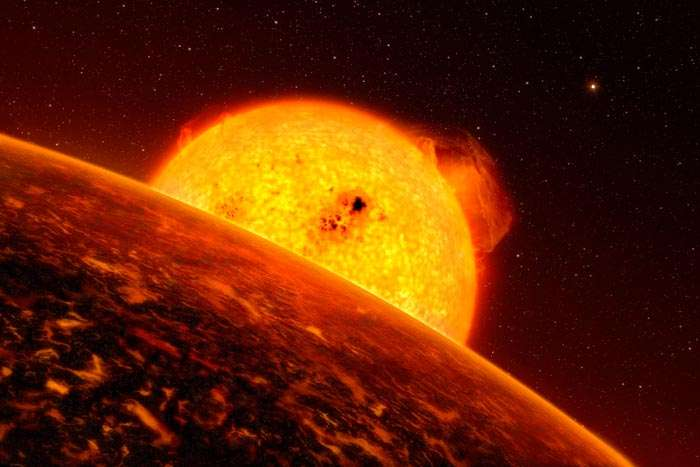 Une vue d'artiste de Corot-7b, une planète rocheuse environ cinq fois plus lourde que la Terre et gravitant à seulement 2,5 millions de kilomètres de son étoile (contre 149 millions pour la Terre). L'année y dure seulement 20,4 heures. © ESO/L. Calcada