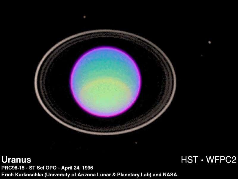 Les anneaux et quelques-uns des satellites sont visibles sur cette image d'Uranus prise en 1996 par le télescope Hubble. Crédit : E. Karkoschka / Nasa