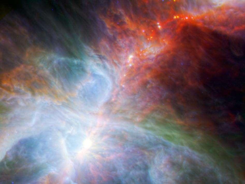 Les télescopes Herschel et Spitzer nous offrent une nouvelle vision du centre de la nébuleuse d'Orion où se cachent de jeunes étoiles dont l'éclat varie très rapidement. © Nasa/Esa/JPL-Caltech/Iram
