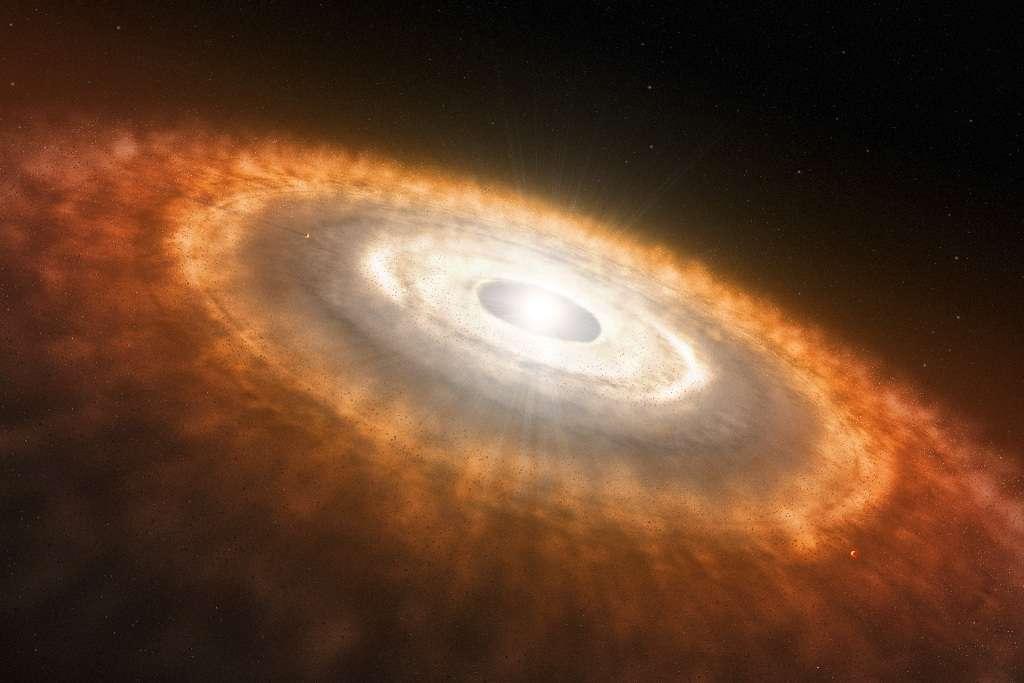 Une vue d'artiste d'un système planétaire en formation. © ESO/L. Calçada