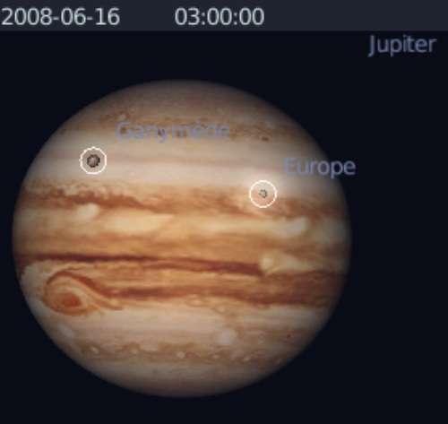 Observez l'ombre des satellites Europe et Ganymède sur la planète Jupiter