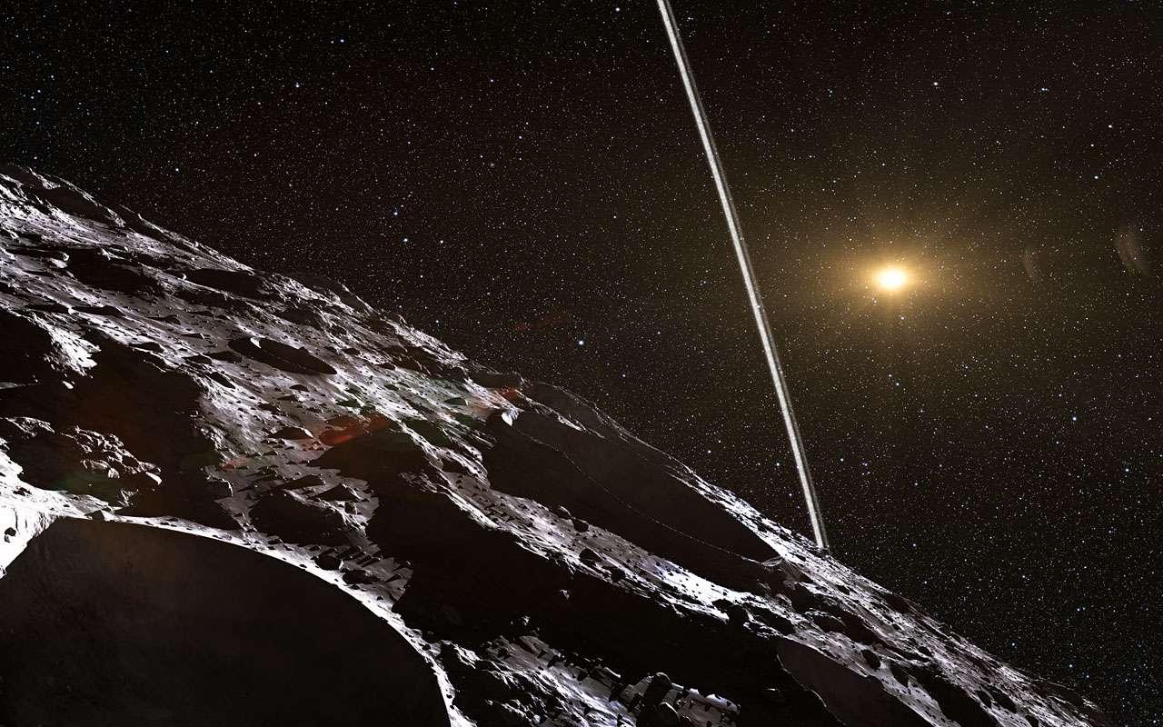 Cette vue d'artiste illustre le paysage qui attend tout visiteur de Chariklo, corps rocheux de la famille des Centaures qui se promène entre Saturne et Uranus. Deux bandes étroites de débris, essentiellement de la glace d'eau, ceinturent l'astéroïde long de 250 km. C'est la première fois que de semblables caractéristiques sont observées autour d'un objet autre qu'une planète géante. © Eso, L. Calçada, N. Risinger