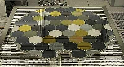 Un des ensembles de pièges à particules au banc de montage