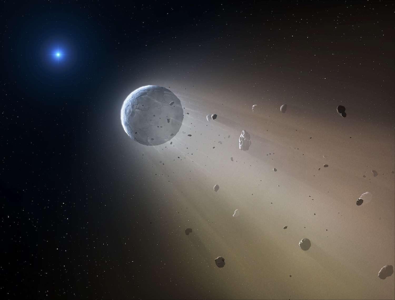Illustration d'une planète en déconstruction autour de la naine blanche WD 1145+017. Les observations de Kepler indiquent qu'un anneau de débris entoure l'étoile compacte. Un objet aussi gros qu'un astéroïde occulte jusqu'à 40 % de la lumière de l'étoile compacte toutes les 4,5 heures et s'accompagne d'une trainée de poussières. © CfA, Mark A. Garlick