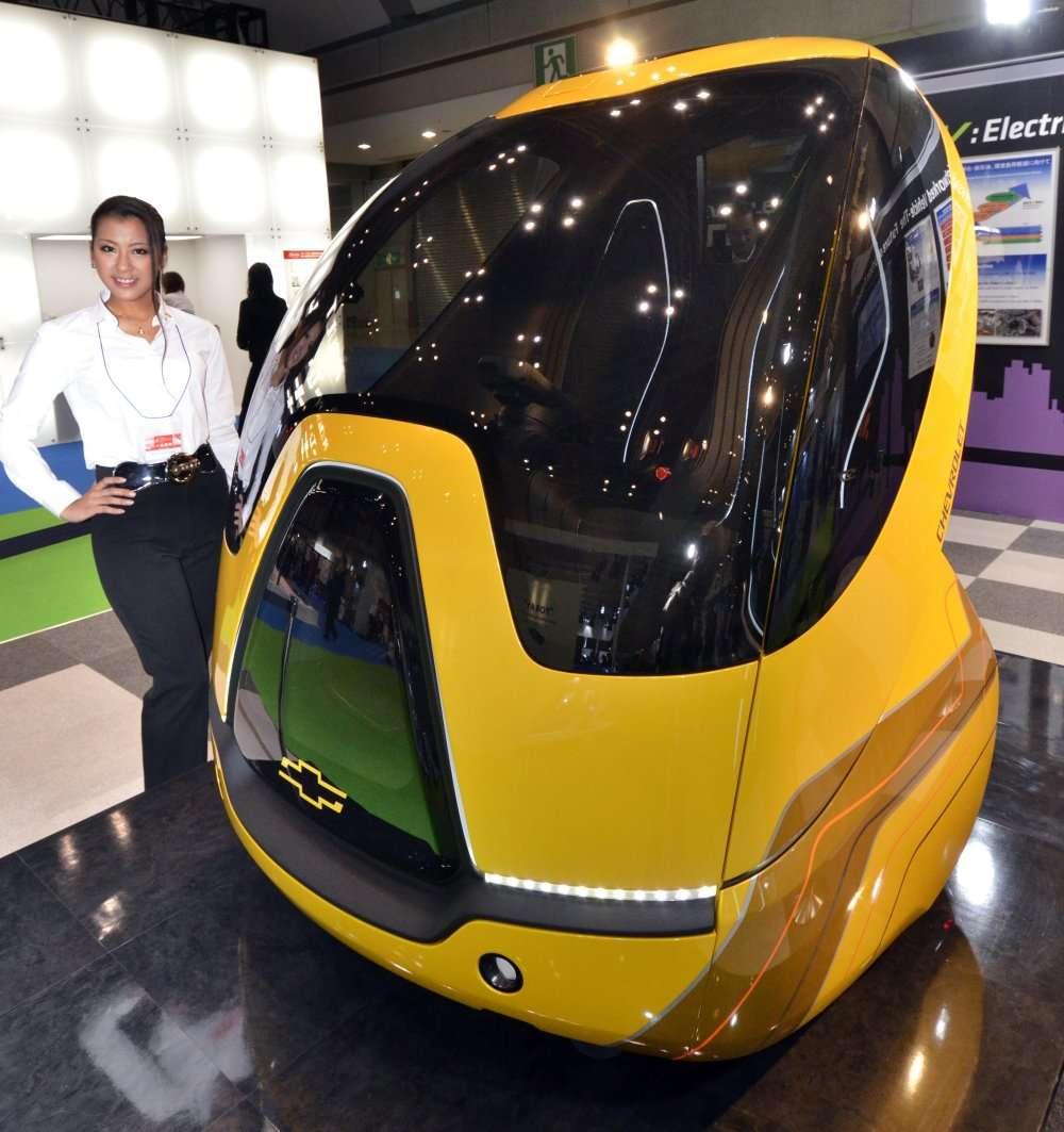 L'étrange Chevrolet EV-V, pour Electric Network-Vehicle, est électrique mais aussi automatique et pleine de gadgets. Mais ce n'est qu'un concept... © AFP Photo / Yoshikazu Tsuno