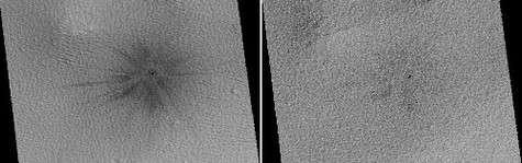 Ce cratère situé dans la partie méridionale d'Ulysse Patera n'existait pas sur les images prises par l'orbiteur de Viking 2 en 1976. Aperçu pour la première fois en 1999 par Mars Global Surveyor, il montre de nombreux rayonnements d'éjectas foncés. En 200