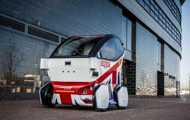 Ce petit véhicule paré aux couleurs de l'Union Jack est l'un des modèles de véhicules autonomes qui seront testés d'ici peu sur routes ouvertes au Royaume-Uni. © Transport Systems Catapult
