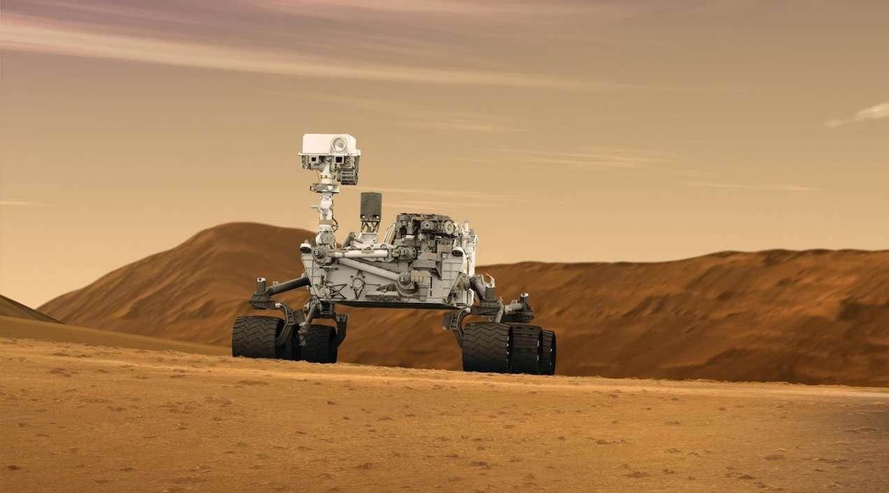 Le rover Curiosity (une vue d'artiste, bien sûr), tel qu'il doit se présenter actuellement, sur la planète Mars. Le mât est levé, ou va le faire, pour commencer à inspecter les alentours. © JPL, Caltech