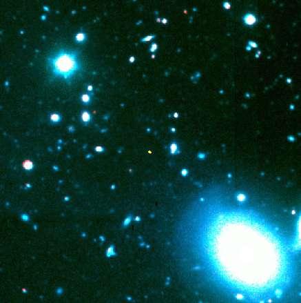 Image du quasar J1148+5251 prise avec le télescope Keck de 10 m (le point jaune). Tous les autres objets de l'image sont beaucoup plus proches. Crédit : Keck.S.G. Djorgovski, A. Mahabal et M. Bogosavljevic, Caltech