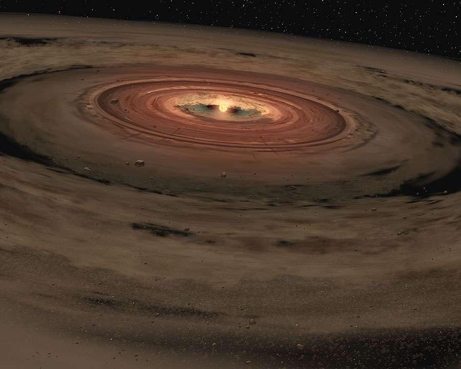 Une vision d'artiste du disque protoplanétaire de notre Système solaire. Les planètes qui y naîtront bouclent leurs orbites dans le même sens, celui de la rotation du Soleil sur lui-même. Les lois de la mécanique imposent que le nuage qui s'est effondré gravitationnellement pour donner ce disque devait être en rotation. © Nasa, JPL-Caltech