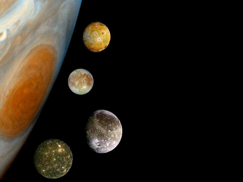 Jupiter et ses satellites galiléens. Des quatre, seule la lune volcanique Io (en haut) ne sera pas visitée par la sonde Juice de l'Agence spatiale européenne. © Esa