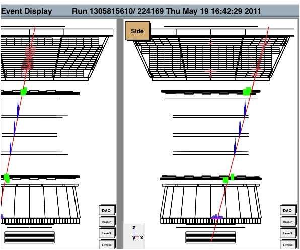 Sur la droite, une ligne rouge montre la trajectoire reconstituée de la particule qui a traversé AMS. © 2011 AMS-02