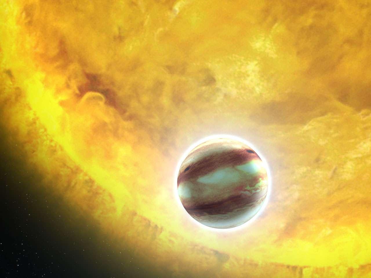 Une vue d'artiste du transit de l'exoplanète HAT-P-7b située à environ 1.044 années-lumière de la Terre. Son diamètre est estimé à 1,4 fois celui de Jupiter. © Nasa, Esa et G. Bacon (STScI)