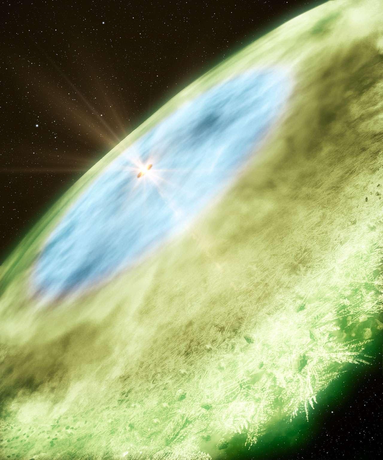 Cette image d'artiste représente ce qu'on appelle une ligne de glace, encore appelée ligne de neige, dans le disque protoplanétaire entourant TW Hydrae. On voit représentés en bleu des grains couverts de glace d'eau dans le disque interne (de 4,5 à 30 UA) et en vert des grains couverts de glace de monoxyde de carbone (CO) dans le disque externe (au-delà de 30 UA). Le passage du bleu au vert marque la ligne de neige du CO. © B. Saxton, A. Angelich, NRAO, AUI, NSF, Alma, ESO, NAOJ