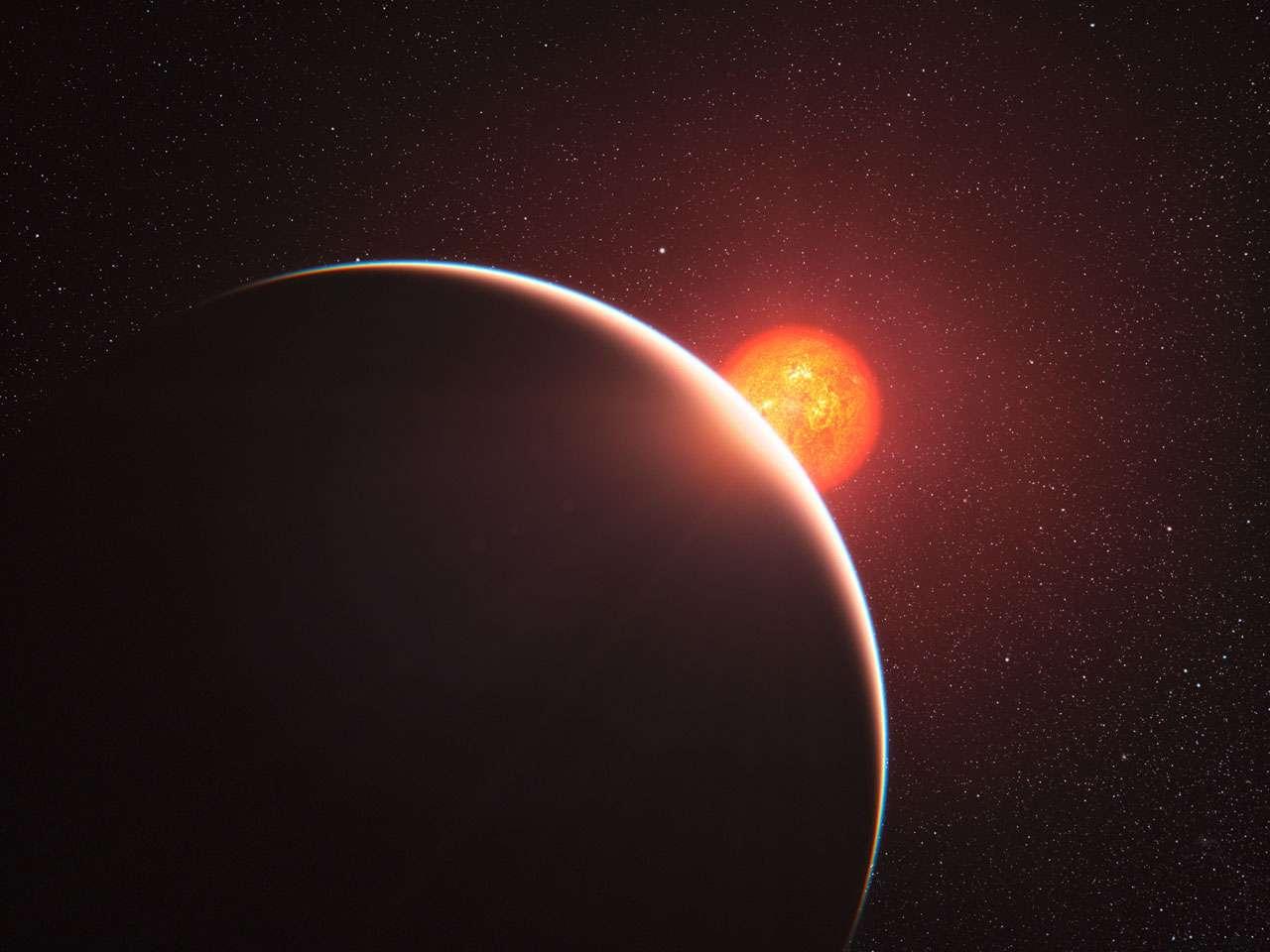 Une vue d'artiste du transit de GJ 1214 b devant son étoile hôte. © ESO/L. Calçada