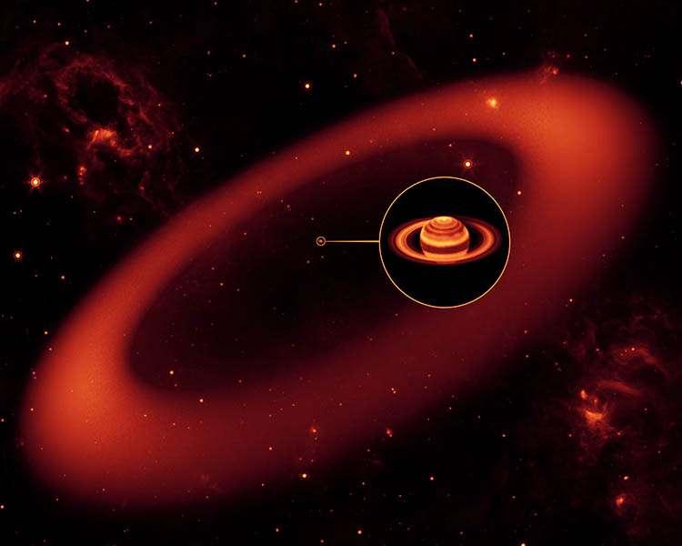 Une vue d'artiste montrant l'anneau géant autour de Saturne si l'on pouvait voir en infrarouge. L'image de Saturne est en revanche bien réelle, bien qu'en fausses couleurs. Elle a été prise dans l'infrarouge avec les instruments du Keck à Hawaï. Crédit : NASA/JPL-Caltech/Keck