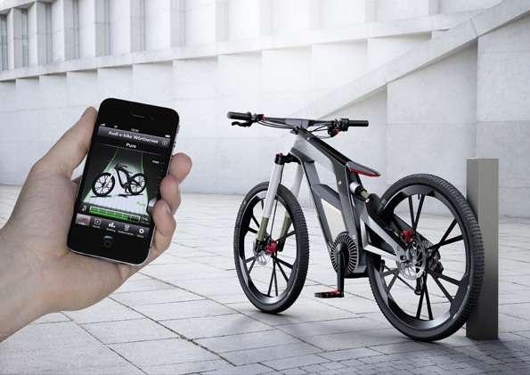 À l'aide d'un smartphone connecté en Wi-Fi, le pilote de l'e-bike peut sélectionner l'un des cinq modes disponibles. Le mobile sert également à déverrouiller l'antivol électronique qui bloque le moteur du vélo. On retrouve la griffe Audi dans le design de cet e-bike. © Audi