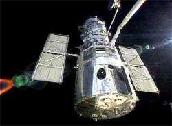 Le bras télémanipulateur a relâché Hubblecrédit : NASA TV