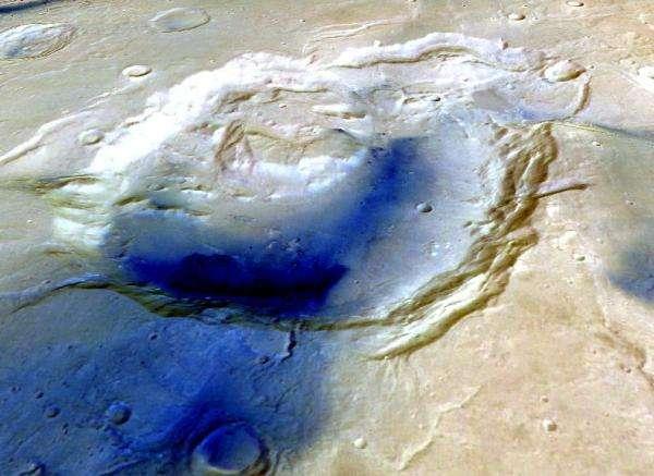 Sur cette image en fausses couleurs obtenue à partir des observations de la sonde européenne Mars Express, la dépression d'Eden Patera, dans la région martienne d'Arabia Terra, est bien visible. On pensait qu'il s'agissait d'un cratère d'impact vieux d'au moins 3,7 milliards d'années (les dépôts représentés en bleu sombre sont plus jeunes). Il s'agirait en réalité d'un édifice volcanique, et peut-être d'un supervolcan. Sept autres structures similaires ont été découvertes dans la même région. © Esa