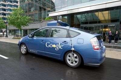 Une Prius automatique de Google dans une rue de Washington. © AFP Photo/Karen Bleier