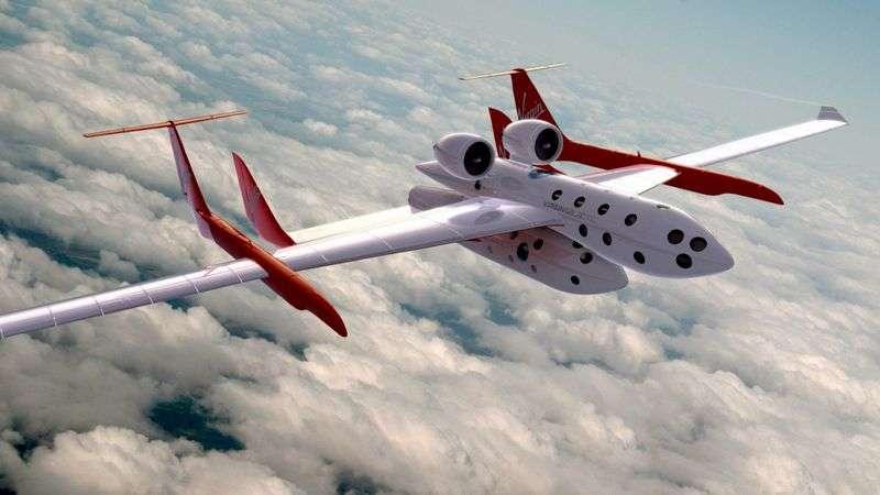 Le Space Ship Two de Virgin Galactic sous son avion porteur, projet de Richard Branson, qui débutera ses vols touristiques suborbitaux l'an prochain. Crédit Virgin Galactic.
