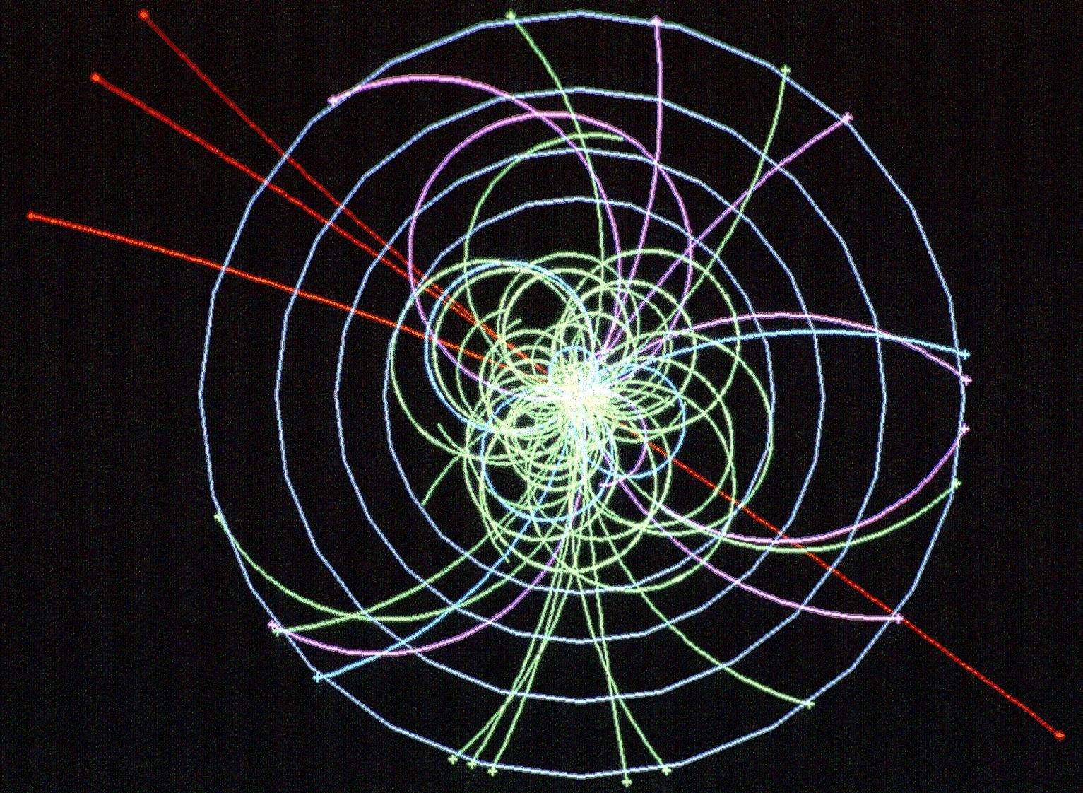 Une simulation de la découverte du Boson de Higgs dans le détecteur d'Atlas. La particule se signale par la production simultanée de 4 muons, lourds cousins de l'électron, dont les trajectoires sont en rouge. Crédit : Cern