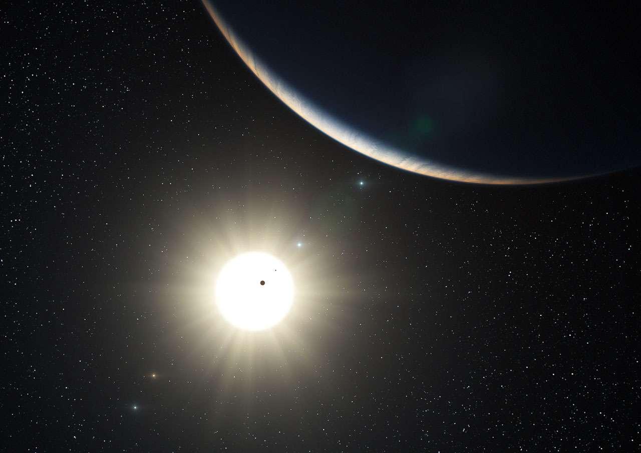 Sur cette vue d'artiste on voit l'étoile HD 10180 avec les 7 planètes qu'elle possède probablement. La planète au premier plan est la troisième du système de HD 10180, sa masse est comparable à celle de Neptune. Les deux planètes intérieures apparaissent comme des silhouettes en transit sur le disque lumineux de l'étoile. Les planètes extérieures au système apparaissent dans le fond du ciel. Crédit : ESO/L. Calçada