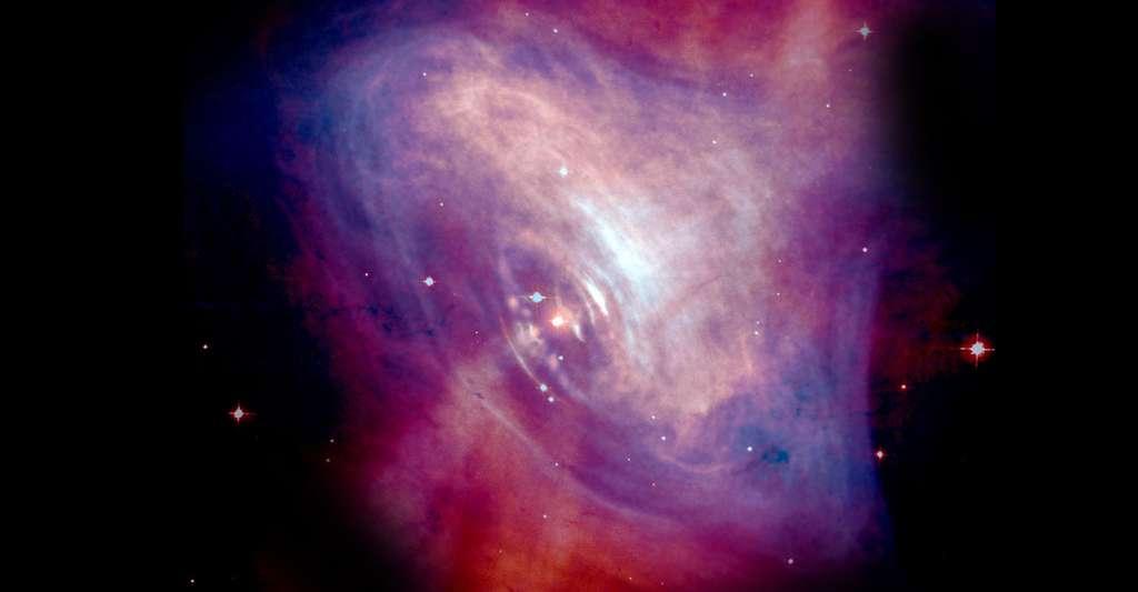 Nébuleuse du crabe. © Optical NASA/HST/ASU/J. Hester et al. X-Ray: NASA/CXC/ASU/J. Hester et al. CCO