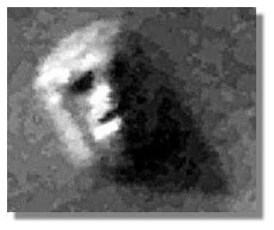 « Cydonia Face » : en 1976, la sonde Viking prend un cliché de ce relief martien qui semble représenter un visage... © Nasa