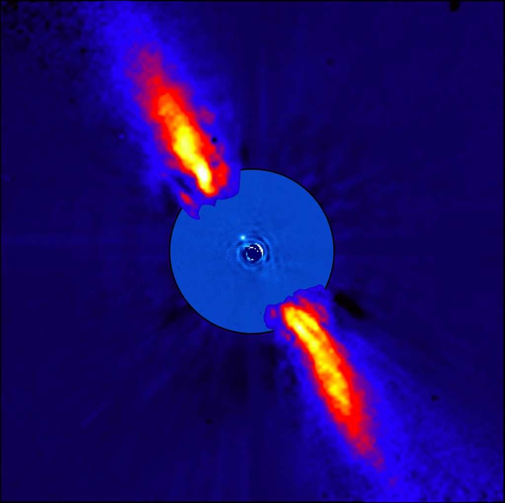 Portrait composite de Beta Pictoris, distante de seulement 63 années-lumière, dans le proche infrarouge. La jeune étoile est masquée pour permettre aux astronomes de mieux distinguer son environnement, animé de collisions frénétiques de comètes que l'on peut aujourd'hui départager en deux familles distinctes. © Eso, A.-M. Lagrange et al.