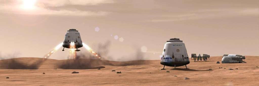 Vue d'artiste de sondes spatiales Red Dragon (à l'atterrissage et au sol), des versions modifiées de la capsule Dragon de SpaceX, qui veut envoyer une colonie de plusieurs milliers de personnes sur Mars. © SpaceX