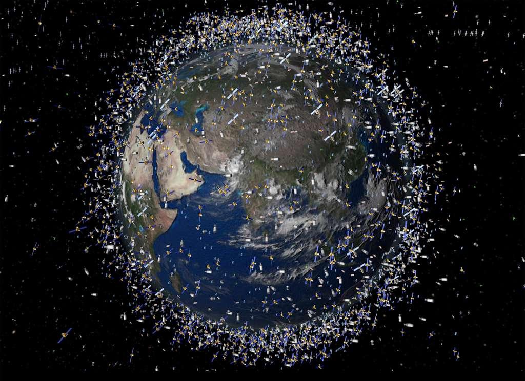 Vue d'artiste des débris spatiaux présents autour de la Terre, aux alentours de 2.000 km d'altitude. L'adaptation de technologies de retour d'échantillons martiens est à l'étude pour la capture de débris spatiaux. © Esa
