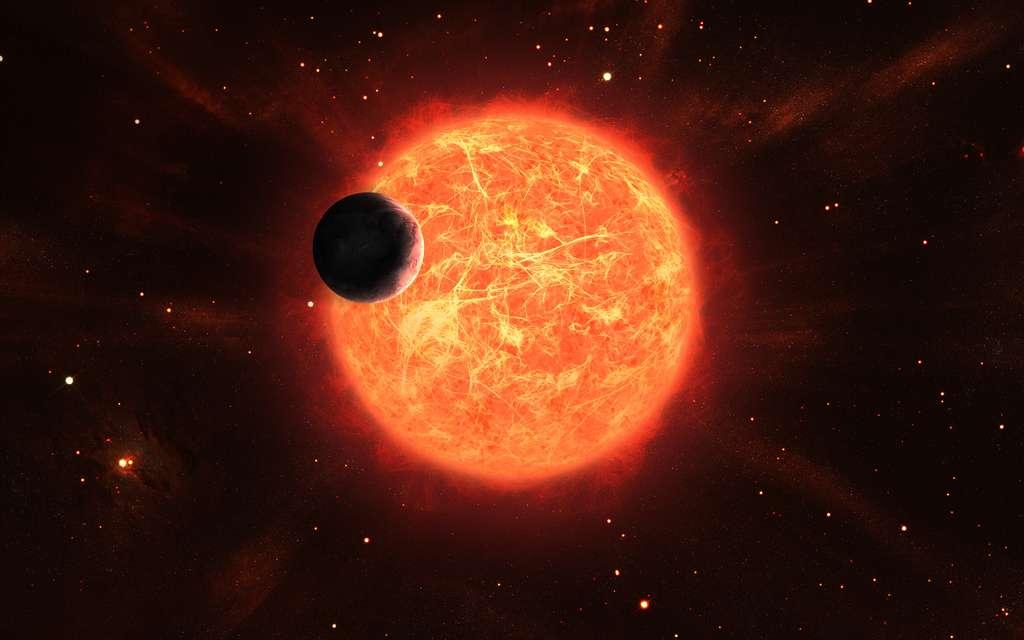 Vue d'artiste d'une planète autour d'une étoile géante rouge. © Lev, Adobe Stock