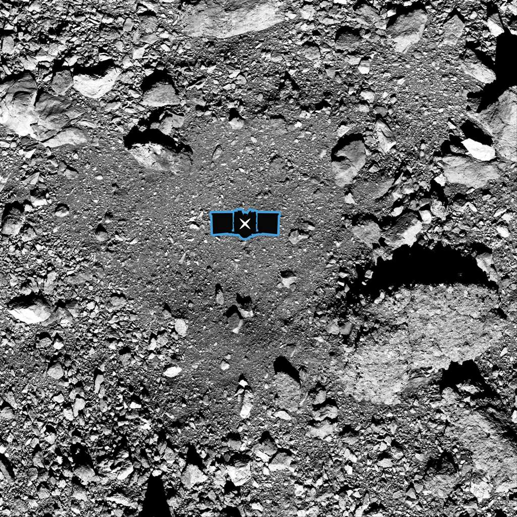 Cette image montre le site d'échantillonnage Nightingale, le principal site de collecte d'échantillons d'Osiris-Rex sur l'astéroïde Bennu. Une représentation graphique d'Osiris-Rex a été ajoutée au centre de l'image pour indiquer l'échelle du site. © NASA/Goddard/University of Arizona