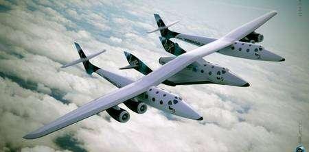 Ensemble avion porteur WhiteKnightTwo et SpaceShipTwo en vol (vue d'artiste). Crédit Virgin Galactic